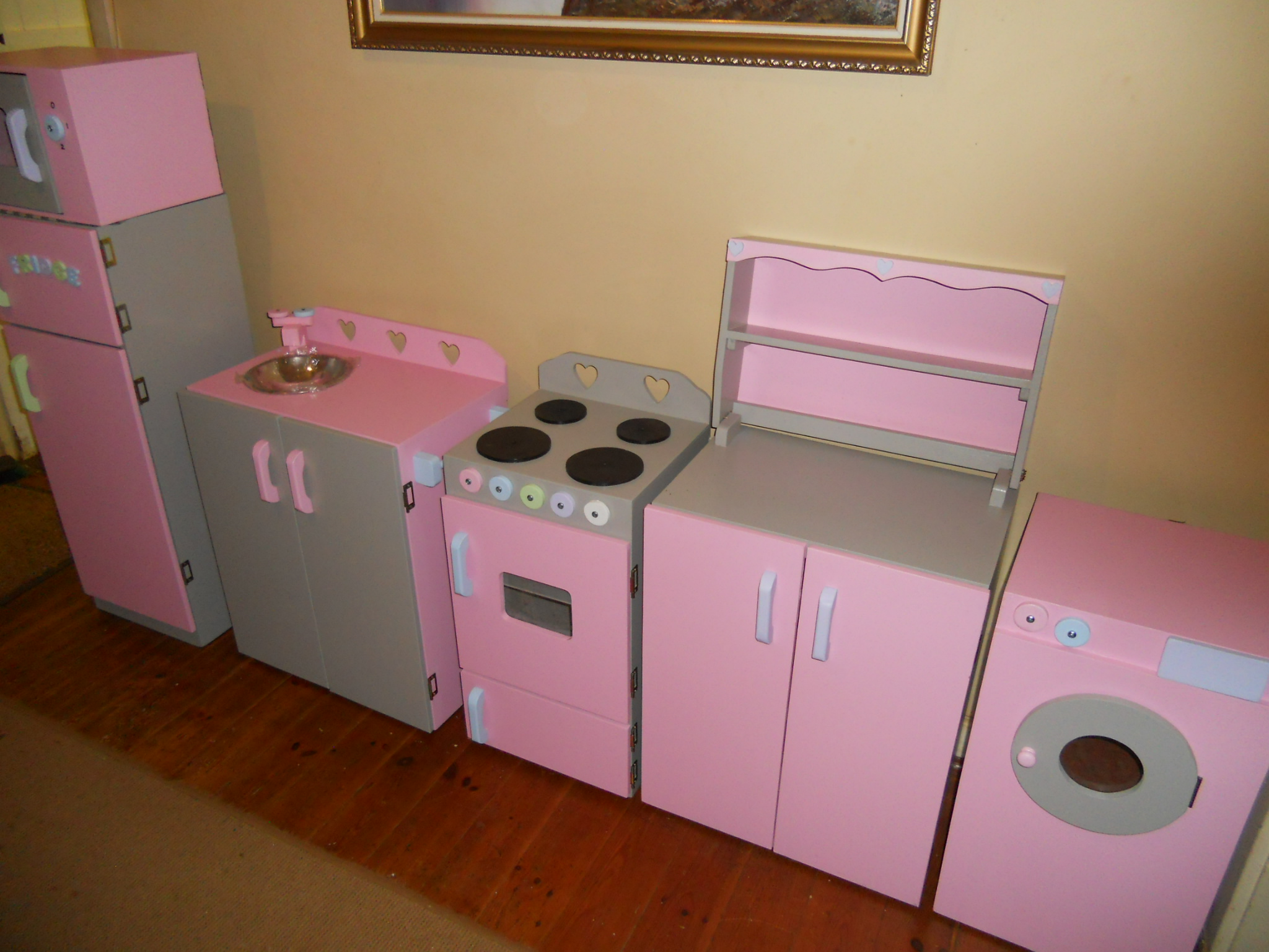 Fridge, sink,stove, dresser, washing machine and microwave painted in Grey and pink